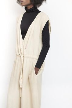 e46148bfb415 Revisited Matters Wrap jumpsuit with v-neckline in oat. Ties at waist with  self