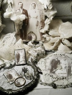 A Little Bit French..this would be a great way to have a display of past family members and their wedding pictures..maybe great grandparents or grandparents.