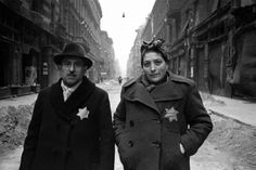 A Jewish couple is photographed in the Budapest Ghetto after the arrival of the Soviet Army in Hungary. February 1945. Image taken by Yevgeny Khaldei.