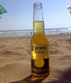 A bottle of Corona on the pacific coast of Mexico. Corona Bottle, Beer Bottle, Corona Beer, Vacation Pictures, Travel Pictures, Photomontage, Ab Inbev, Liquor Shop, Mexican Beer