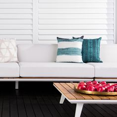 A contemporary outdoor coffee table designed with stylish teak slats.