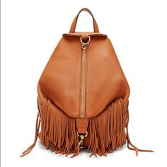 "Rebecca Minkoff Julian Backpack w/Fringe Absolutely amazing backpack!  Only used for 3 day trip   Made from textured leather and finished with our signature dog clip, this backpack is the perfect option for days on the go.  11.25""W x 12""H x 6""D 30"" adjustable shoulder strap 4"" handle drop Custom light gold hardware  3 exterior zipper pockets Top zipper with clasp closure  3 interior slip pockets 1 interior zipper pocket Exclusive lining  Comes with Dustbag!  NO LOWBALLING! NO TRADES  OFFERS…"