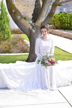 This long sleeve modest wedding dress features a beautiful lace detailing and dainty waistband. This gown is perfect for fall and winter weddings. Available in Nude/Ivory (as pictured) and Sand/Ivory. Nude/Ivory sample available in store. Plus size available in store. Wedding Dresses Lds, Bridesmaid Dresses, Prom Dresses, Lds Bride, Temple Dress, Winter Weddings, Modest Dresses, On Your Wedding Day, Bridal Gowns