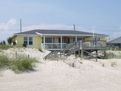 By The Sea West - Emerald Isle, NC Oceanfront Duplex. This oceanfront beach rental has two bedrooms, two bathrooms, 3 cable HDTVs, a DVD player and high speed Internet access,  Experience an excellent ocean view from living area and access to an uncrowded beach.