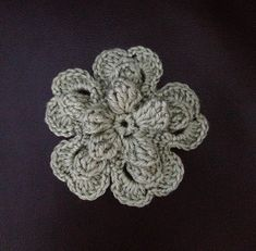 You will learn how to crochet a beautiful flower making popcorn stitches inside of each petal. A little of your patient, four rounds of work and the flower i. Form Crochet, Crochet Flower Patterns, Lace Patterns, Crochet Motif, Crochet Flowers, Crochet Lace, Crochet Hooks, Crochet Embellishments, Crochet Buttons