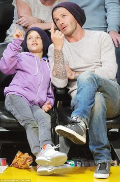 Father and son at a b-ball game...too cute