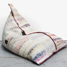 Cute shot of one of our best-selling Kilim Beanbags they're looking for their new forever homes! Originally used as a floor rug Koskela found a resourceful way to repurpose and upcycle this beautiful fabric into one-off unique beanbags. Each one is hand-made & entirely unique in tone & pattern. This time round youll notice that each beanbag & cushion has a unique tiny fabric square detail of recycled fabric making them extra special as well as featuring our signature leather Koskela embossed…