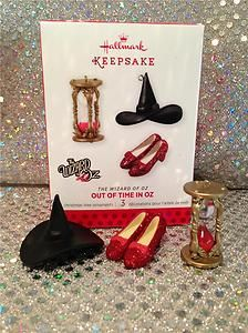 3 iconic items from Wizard of Oz- ruby slippers, Wicked witch of the west black hat, and hourglass