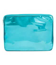 Turquoise. Shimmery metallic laptop sleeve with zip at top. Lined. Size 3/4 x 10 1/4 x 13 1/2 in. Fits laptops up to 13 in.
