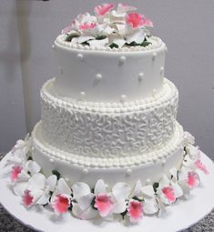 White tiers with white and pink orchids