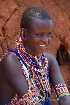 Africa | Maasai woman sitting at her hut in the manyatta, Kenya | © Ariadne Van Zandbergen