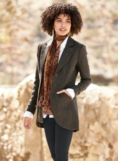 Finely tailored details—a high notched collar, shaped seaming, angled pockets and curved cutaway hem with back vent—define our jacket. Exquisitely constructed in a black and brown herringbone tweed of alpaca (47%), wool (46%) and nylon (7%); signature lining.