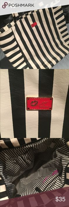 Black and white striped Betsey Johnson tote. Black and white striped Betsey Johnson tote bag. Red emblem on the front. Never used. Betsey Johnson Bags Totes