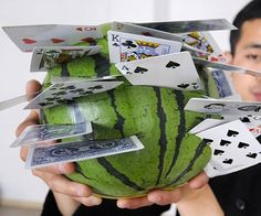 Watermelons. You poor bastards. Always on the receiving end of novelty weapon violence. The Gotcha Cap. The Unbreakable Slugger Umbrella. The Blade Driver Crossbow. And now...the Queen of Hearts. That bitch. This seems incredibly dangerous and stupid   We've always known a royal flush is a
