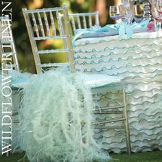 From Wildflower Linen... how incredible are these chair covers???