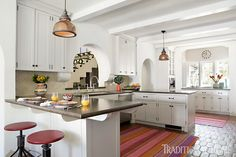 Spanish Colonial Revival Residence in Holmby Hills — Tim Barber Ltd. Spanish Style Homes, Spanish Revival, Spanish House, Spanish Colonial Kitchen, Painted Ceiling Beams, Tim Barber, Front Courtyard, Celebrity Houses, White Cabinets