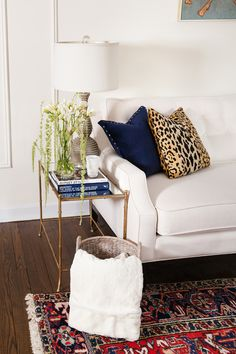 Yana Puaca's Chicago Home Tour #theeverygirl #white sofa #livingroom