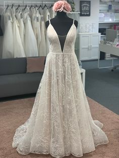 Stunning a line lace gown with plungr neckline and spaghetti straps Discount Designer Wedding Dresses, Dream Wedding Dresses, Bridal Boutique, Spaghetti Straps, Townhouse, Neckline, Gowns, Lace, Fashion