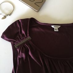 Calvin Klein top Very cute and flattering top! The metal on the sleeves has a little bit of wear on the corners other than that it is in great condition Calvin Klein Tops