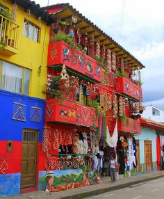 Colorful buildings in Ráquira, Boyacá department,. Colorful buildings in Ráquira, Boyacá department, Colombia~~ South America Destinations, South America Travel, Colourful Buildings, Beautiful Buildings, Colorful Houses, Unusual Buildings, Ushuaia, Oh The Places You'll Go, Places To Travel