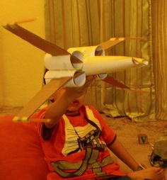 DIY: X-Wing Fighter from Toilet Paper Rolls. I love the simplicity of this clever lil art project that lil boys and BIG boys alike will enjoy doing together....The X-wing fighter made from left-over toilet paper rolls...Get ready for some BIG smiles in and outside the classroom!