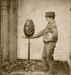 Early Stereo card, c 1880. Boy with JOL.