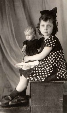 Photo of a little girl with her doll.