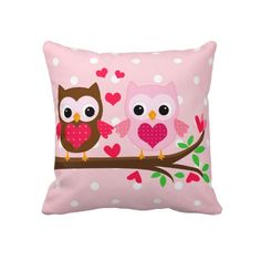Cute owl couple with a brown owl and a light pink owl sitting on a branch of tree. Cute bright pink hearts around. Delicate pink and white polka dots pattern on the background. Girly Template is the store where these pillows can be found.
