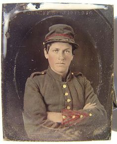 Unidentified young soldier in Confederate artillery uniform.  He looks awful young