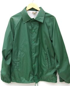 Green lined jacket with nylon outer shell, great as a rain jacket or layered as a windbreaker. Snap front closure, side pockets, soft inner lining. Elastic cuffs have little stretch left. Draw string at the bottom. Brand: Hartwell Jackets  Size: M  Inner: Acetate  Outer: Nylon    Measurements (laying flat):    Shoulders: 20  Chest: 22  Sleeve Length (from shoulder): 27  Total Length: 28