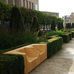 """Gardens of Albertine // Brussels >>>  Polish designer Pawel Gobelny created the bench """"Monolit"""". Sculptural against the creation of plywood and aluminum curved stretches his lover to come between clipped hedges of the garden."""