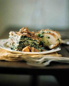 Wild Mushroom and Spinach Lasagna. do not use wine, use veggie broth. Use almond milk and vegan cheese. Try zucchini for noodles or pre-cooked or not pre-cooked eggplant slices sauteed in olive oil and salt for noodles.