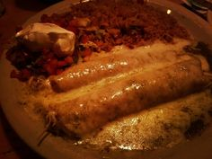 """This is a really good plate the """"green chicken enchiladas"""". . . . #texmex101 #texmexucation #texmex #enchiladas #chicken #green #sauce #tomatillo #melted #cheese #texas #mexicanfood #houston #lupetortilla #ighouston #enjoylife #foodies #foodstagram #foodphotography #instafood #yum #nomnom"""