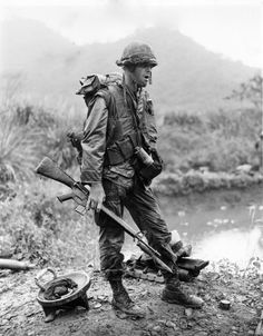 Private R. Jones of the 2nd Battalion, 7th Marines takes a standing break during Operation Pitt, 12 miles north of Danang, December, 1967. (Lcpl Brumch/U.S. Marine Corps/National Archives) ~ Vietnam War