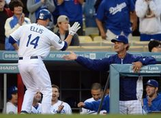 Mark Ellis, left, is greeted by Don Mattingly after his home run in the Dodgers 7-3 victory over the Rockies on May 11, 2012.