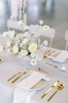 Minimalistic wedding reception with gold accents.