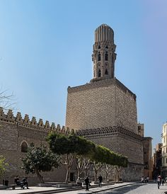 Al Hakem Mosque (The Enlightened Mosque) is a major Islamic religious site in Cairo, Egypt. named after Imam Al-Hakim bi-Amr Allah (985–1021), the sixth Fatimid caliph,16th Fatimid/Ismaili Imam and the first to be born in Egypt, located in Islamic Cairo, on the east side of Muizz Street, just south of Bab Al Futuh. The mosque have two minarets that stood independent of the brick walls at the corners. These are the earliest surviving minarets in the city and they have been restored at var