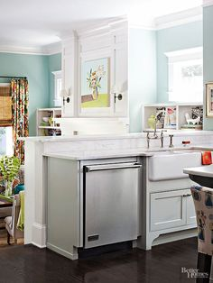 The kitchen peninsula holds a dishwasher and apron-front sink that overlooks the family room. The sink's oversize design is perfect for washing trays and other entertaining pieces.