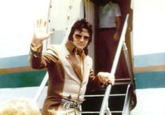 boarding his plane to leave Greensboro, NC for Asheville, NC on July 22, 1975