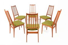 Fantastic set of six Danish modern highback mid century dining chairs in teak. These will pair perfectly with any vintage or modern table, and
