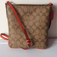 "NWT COACH Signature NS Crossbody ""Khaki / Brown"" signature coated fabric with ""Orange"" crossgrain leather trim and gold tone hardware.  Fully lined. Zip top. Leather zipper pull. Interior, one open pocket.   44 inch adjustable strap for shoulder or cross body wear. Coach Bags Crossbody Bags"