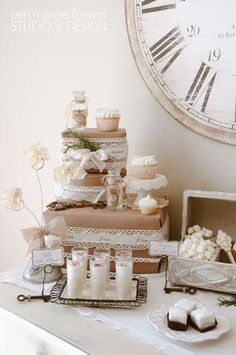 That stack of boxes gives me an idea: could do faux wedding cake on a display table (next to guest book or something) with paper-covered boxes decorated with lace/flowers to hide the separation of boxes. Cheap and pretty!