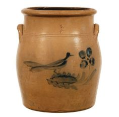 """STONEWARE CROCK 19th c. stoneware 2-gal. crock, with blue bird sitting on a bush with four large blueberries, 11"""" h."""