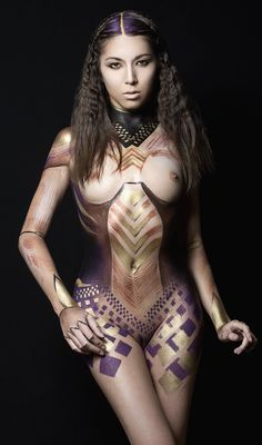 bodypaint by Jessica deBen. Photo Barry Druxman. Model Idiivil. Hair Helen R Evans. bodypaint, body paint, tribal, makeup design, body makeup, gold, metallic, art nude