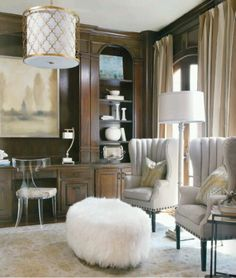 Gorgeous wingback chairs with nail studs, lucite desk chair, and a fab white ottoman. Love!!