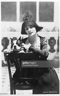 Postcard portrait of Russian ballerina Anna Pavlova (1882 -1931) as she poses with a dog, early twentieth century.