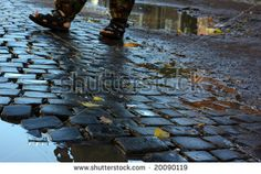 Old street in Ukraine (Lviv) with cobblestone. A view just after rain