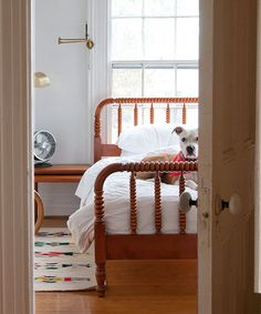 Manhattan Nest: guest room Love the light, white walls, wood furniture/floor. And puppy in the bed.