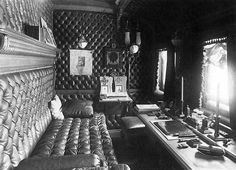The Private Study and Sleeping-Car of Emperor Nicholas II.  The study of Nicholas II was provided with furniture of Karelian birch and beech upholstered in brown leather. On the table, also upholstered in gold-stamped leather stood a bronze gilded writing set of twelve objects. Books, magazines, maps, albums and photographs were also kept there. The study was illuminated by gilded bronze sconces; the floor was covered with a cherry-colored plush carpet.