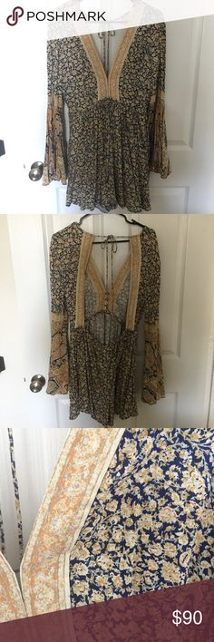 Free People Once Upon A Summertime floral romper Floral printed romper with plunging neckline and hidden hook-and-eye closures. Long sleeves with flared, bell cuff and a low open back with an elastic waistband for an easy fit. Worn only 1 time. 100% rayon, machine wash cold. Free People Other